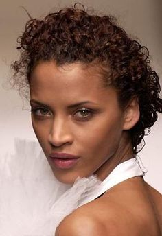 Noemie Lenoir. Slicked back silky curls.