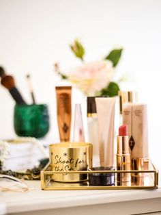 Get The Glow- My Favourites for Glowing Skin | Dressing Table setting with Glow primers, books and brush holder_