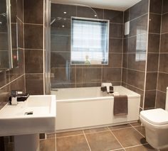 The family bathroom with @villeroyandboch suite and @porcelanosa tiles. #Strata