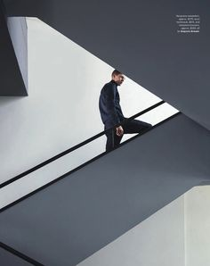 German Model Tim Schuhmacher in an editorial shot by Anuschka Blommers and Niels Schumm in the buildings of the famous Bauhaus school of arts and design in Germany for the Australian GQ September 2013 Issue