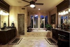 Lighting, marble tile floor covering, white and tan striped wall covering, black marble counter tops.