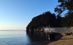 ストックフォト : Scenic View Of Sea By Cliff Against Clear Sky