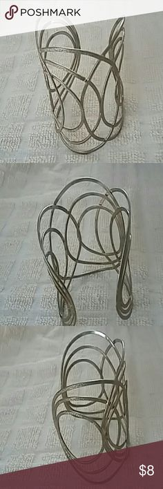 Hammered brass swirl cuff bracelet Bold hammered wire cuff has concentric circle swirls and loops. Very large but lightweight. Funky 70s vibe statement. Great for the boho look! Very good vintage condition  but metal is slightly faded in some places. Jewelry Bracelets
