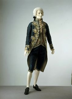 By the 1790s men's Court dress favoured coat and breeches in a dark, patterned silk or velvet, with a contrasting light-coloured waistcoat. Although both coat and waistcoat were lavishly embroidered in coloured silk thread, the heavy metal adornment of earlier Court dress was gone. As befits the conservative nature of Court dress, the style of this suit is similar to daywear in the 1780s, retaining the curved-back front instead of the cut-away coat, newly fashionable in men's daywear.
