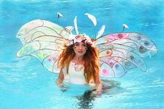 I took this portrait of Twig the Fairy as she waded through shallow water just before we started the underwater photo shoot.  You can see the setting sun shining through her wings and her windblown hair.  I took this candid shot with my backup camera a Canon EOS 40D as my Canon 5D Mark II was inside the underwater housing.  Though it will never be used in a calendar or the book I thought it was too pretty not to post.  www.facebook.com/twigthefairy