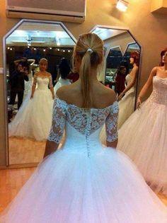 Off shoulder lace bodice wedding dress