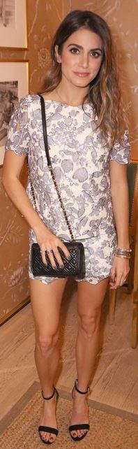 Grey print tee, black handbag, and ankle strap sandals