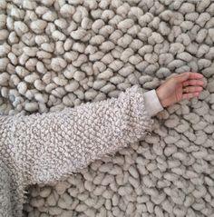 Nanushka sweater, Kneeland mercado rug