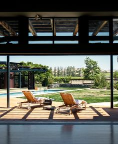 """Twenty-foot-wide doors from Solar Innovations offer easy access to the deck. """"Solar Innovations was the only manufacturer at that time that had a pocket multi-slider with a good ADA threshold,"""" says architect Erick Mikiten. """"They almost look like steel, but are thermally broken aluminum."""