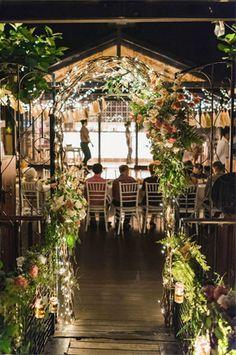 midsummer night wedding inspired gate with floral garland decor lanterns - brides of adelaide