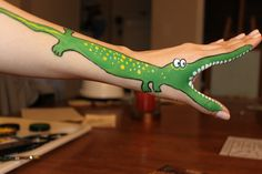 An alligator face painting, or crocodile face painting drawn on an arm Animal Face Paintings, Animal Faces, Painting For Kids, Painting & Drawing, Professional Face Paint, Cool Kids, Kids Fun, La Art, African Animals