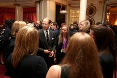 Prince Edward, Earl of Wessex talks to athletes during a reception for the Team GB Olympic and Paralympic medalists at Buckingham Palace