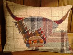 Handmade Highland Cow cushion by Countryhouseinterior on Etsy, £45.00