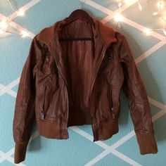 Brown leather jacket Durable and stylish! Barely been worn! Not sure what the brand is  price negotiable! Jackets & Coats