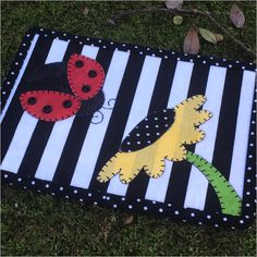 The ladybug is exploring the world and has come across a pretty sunflower! Keep this mug rug on your desk or side table and smile every time you see it ...