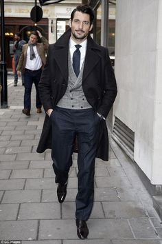 Good company: Male model David Gandy also arrived for the festive affair
