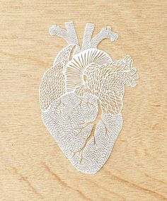 A hand-cut paper heart as delicate as the real thing. #etsy