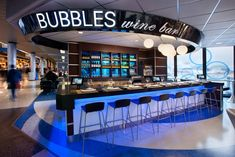 Chute Gerdeman designed the space, which evokes a classic Windy City-style jazz club feel with a black-and-white color scheme, piano, globe lights and blue light emanating from beneath the bar. Great American Bagel, Garrett Popcorn Shops, Chicago Airport, O'hare International Airport, Ice Bars, Light Snacks, Bar Grill, Wine Parties