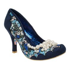 Feel pretty with Pearly Girly! This heel features a navy blue floral print with a blue scalloped contrast fabric at the toes and ankles. The heel is adorned with a blue spotted fabric, and a cluster of white pearls glimmer along the throat line.