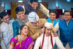 Kaanpili. A fun Maharashtrian custom where the bride's brother pulls the ear of the groom and warns him that he'd better treat his sister well!