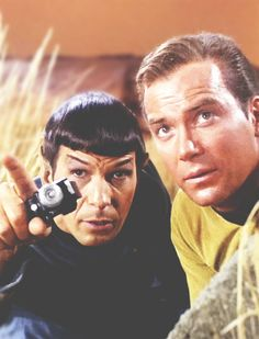 Captain.  I shall attempt to fire my phaser from my console, over Sulu's head, bank the beam off the Yeoman's beehive then Uhura's posterior causing it to extend out to the screen where it will penetrate the empty Romulan Ale bottle.  I am 94% certain you will owe me the sum of 10 Credits.