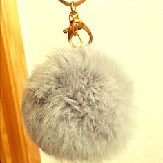 Gray Rabbit Pom. New New. Never used. Real rabbit. Would look great on a handbag. Price is firm. Large size. Gold hardware. Accessories