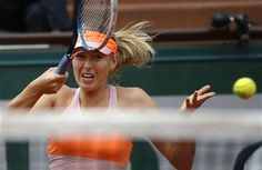 Russia's Maria Sharapova returns the ball to Argentina's Paula Ormaechea during the third round match of the French Open tennis tournament at the Roland Garros stadium, in Paris, France, Friday, May 30, 2014. (AP Photo/Michel Euler) ▼30May2014AP|Sharapova advances to 4th round with 6-0, 6-0 win http://bigstory.ap.org/article/sharapova-advances-4th-round-6-0-6-0-win #Maria_Sharapova #French_Open #Internationaux_de_France_de_tennis #Torneo_de_Roland_Garros