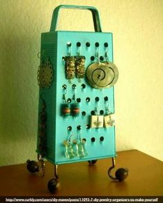 Purposed Cheese grater into jewelery display.
