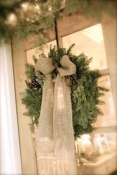 Simple Christmas wreath with burlap bow.