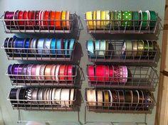 Wall mounted ribbon organization from Ikea BYGEL wire baskets. (http://www.ikea.com/us/en/catalog/products/90072648/)
