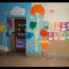 Lorax door decor with alliteration for Read Across America. Feather boa truffula trees:)