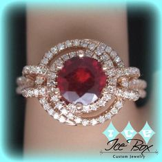 Diamond Rings Ruby Engagement Ring Round set in an Rose Gold diamond know halo setting - BETTER BLING for LESS! In The IceBox has an amazing selection of beautiful, affordable engagement, birthstone and right hand rings! Custom orders are welcome. Diamond Knot, Diamond Jewelry, Diamond Rings, Gold Jewelry, Gemstone Jewelry, Jewelry Rings, Vintage Jewelry, Morganite Engagement, Engagement Rings