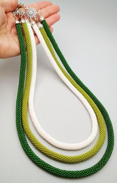 White and green multi-strand beaded rope necklace Modern shiny summer stule necklace Layered bead rope necklace 3 in 1 beaded rope necklace bead crochet necklace Bead Crochet Patterns, Bead Crochet Rope, Beaded Crochet, Rope Necklace, Crochet Necklace, Necklace Ideas, Necklace Designs, Necklace Set, Pearl Necklace