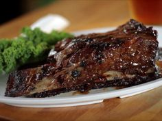 """BEEF SHORT RIBS RECIPE: ~ From: """"Food Network.com"""". ~ Recipe Courtesy of: BEN GROSSMAN  and CRAIG SAMUEL, The Smoke Joint (Diners, Drive-ins and Dives ~ Matches Made In Heaven). ~ Prep.Time: 20 min; Inactive Prep.Time: 13 hrs, 30 min; Cook Time: 14 hrs; Total Time: 27 hrs, 50 min;  Level: Intermediate; Yield: (4 servings)."""