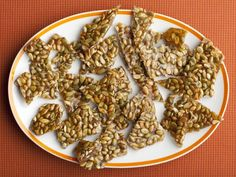 Turn hulled pumpkin seeds into a cayenne pepper-laced brittle.