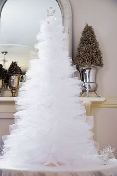 Make this beautiful white tulle Christmas tree this festive season. It& easy to cut out and assemble using our step-by-step photos.The White is so Pretty but with my Theme this Year being basically Candy, I would like to try this in Pastel Pink, Purp Tulle Christmas Trees, Silver Christmas Decorations, Beautiful Christmas Trees, Diy Christmas Tree, Blue Christmas, Outdoor Christmas, Christmas Holidays, Christmas Cactus, Christmas Projects