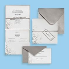 Silver and White Pocket Invite - I got these from Michael's and to make them unique I added stamped snowflakes in silver and blue ink... it came out amazing!! people thought they were bought that way