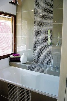 A great way to add interest to large glass tile, insert a bold stripe of mosaics!