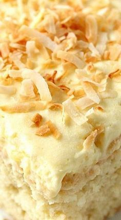 Coconut Pineapple Cake Recipe - sweet and delicious coconut cake with light and fluffy whipped pineapple frosting! Perfect Summer dessert! The coconut cake has a tender crumb and melts in your mouth, all thanks to buttermilk which I my favorite to use in cakes. This frosting is made from just 3 ingredients stirred together; it's light, creamy and irresistible!