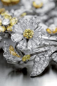 Bvlgari ~ White diamonds and yellow diamond accents.