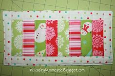 Mug Rug - Cute! I like wintery, not christmasy. So the light greens and pinks are a nice way of doing reds and greens without screaming xmas as I do not celebrate.