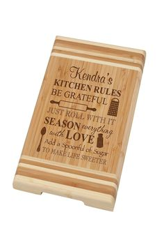 """The perfect companion to mealtime prep, this personalized bamboo cutting board is great for slicing and dicing. Add an image, name or date to make a one-of-a-kind gift for a family or friend. To provide your personalization information, please sent an email to """"stylist@shoptiques.com"""". Be certain everything is spelled correctly and any dates are correct as there are no returns on personalized items.    Measures: Weight: 1.8 lbs;0.75"""" D x 7.75"""" W x 11.75"""" H   Bamboo Cutting Board by P Graham…"""