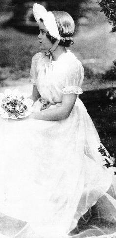 Grace & Family:  Grace Kelly, 15 years old, at her sister Peggy's wedding in 1944.