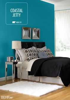 Bring the beach home by painting your bedroom walls with a coastal-inspired paint color like Coastal Jetty blue. This vibrant BEHR paint color looks great with black and white decor and metallic accents for a sophisticated feel.