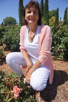 My Day 18 outfit in the Memorial Rose Gardens, El Paso, Texas - white tee Everlane, white cropped skinny jeans Loft, pale peach cardigan Old Navy, gold sandals Target, sea shell necklace from eBay.