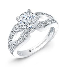 ENG-1037 - This 14kt white gold engagement ring features a split-shank design with 32 pave-set full-cut round brilliant diamonds that weigh 0.44 points in total.