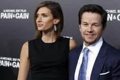 "Actor Mark Wahlberg and his wife Rhea Durham arrive at the premiere of his new film ""Pain & Gain"" in Hollywood, Calif."