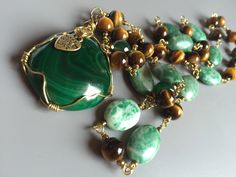 Goldplatted cooper wire wrapped necklace, malachite pendant semi precious stone with tiger eye, agate and jade beads by SparkleWoodJewelry on Etsy https://www.etsy.com/listing/484819982/goldplatted-cooper-wire-wrapped-necklace