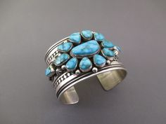 Navajo jewelry artist, Albert Jake, created this detailed Sterling Silver cuff bracelet with 12 BEAUTIFUL Kingman Turquoise stones.