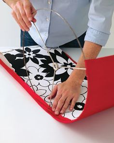 DIY lampshade instructions. Definitely doable. Supply list: lampshade rings, double-stick adhesive paper, fabric (plain inside, patterned outside, in my case)